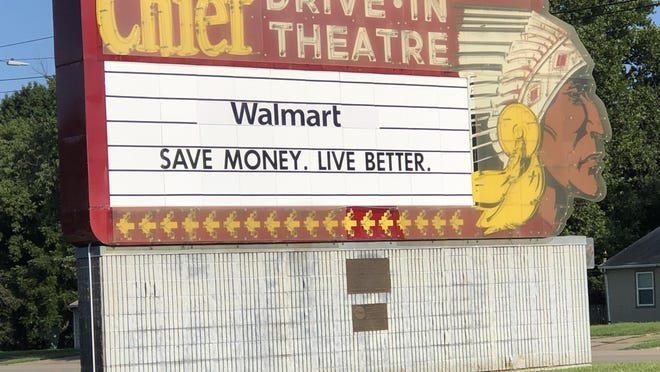 This neon sign, which advertised a former drive-in theater once located at the same site, stands near the entrance to the Walmart at 1301 S.W. 37th, which announced Friday evening on Facebook that it will provide an opportunity for people to sit in their cars and watch big-screen movies on its property.