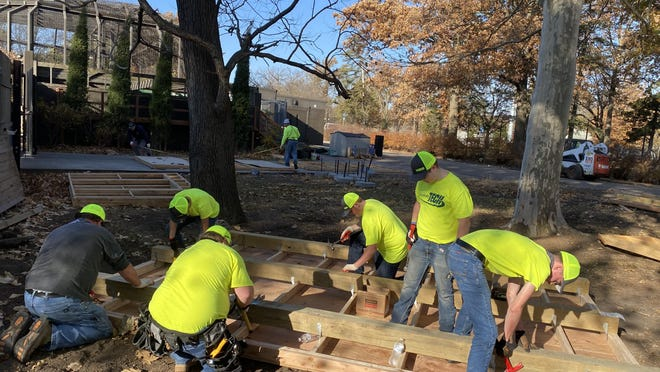 A group of Washburn Tech carpentry students spent Saturday constructing cottages that will be a part of the Topeka Zoo's Zoo Lights holiday village.