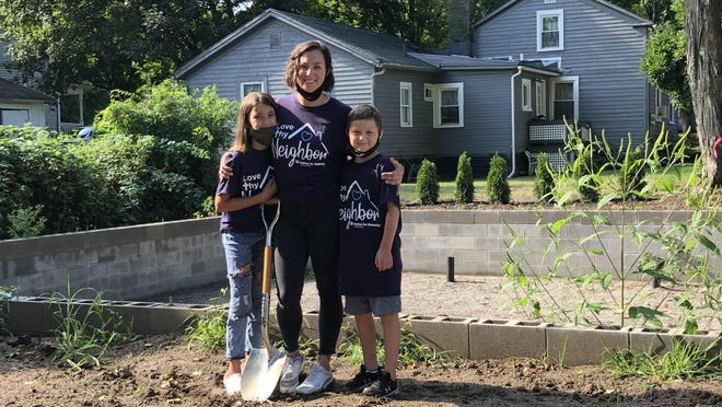 Construction is under way at 412 E. Maple St., Adrian, for the Newell family's new home. Pictured, from left, are Teagan, 11, Emily and Elijah, 7.
