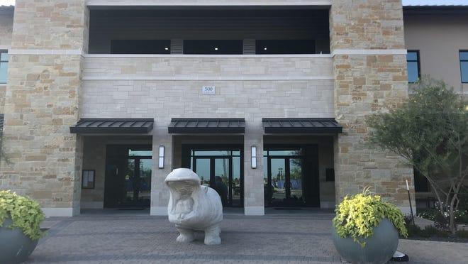 A hippo statue greets visitors at Hutto City Hall.