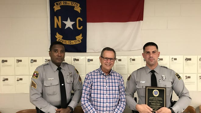 Sgt. H.L. Dorty Jr., Bob Latta, president of AM Optimist of Gastonia, and State Trooper Timothy P. Gagnon.