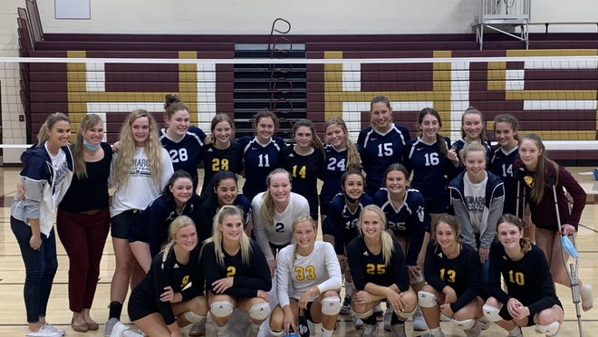 The Thomas More Prep-Marian and Hays High volleyball teams gather for a photo after the teams played each other in the HHS Maroon and Gold Invitational final on Saturday at Hays High. TMP won the title match in three sets.