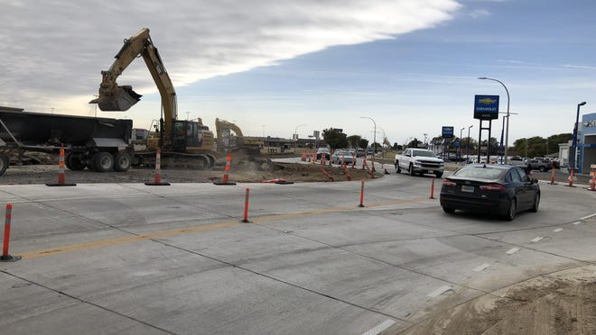 Drivers on Friday drove the new west side lanes of the hourglass roundabout at 32nd and 33rd streets, which Smoky Hill Construction opened Thursday.