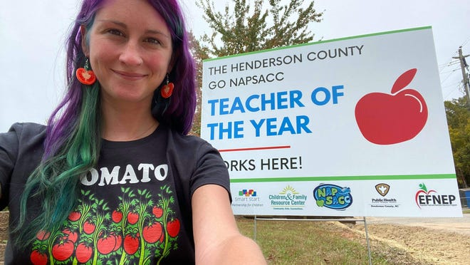 Jodie Williams, early educator at Bell's School for People Under Six in Fletcher, is pictured with her Go NAPSACC Teacher of the Year sign that will be displayed at the school.
