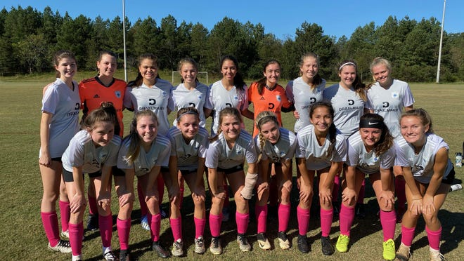 The Carolina Football Club of Hendersonville poses for a photo recently. From left to right are, top row: Cheyenne Sherman, Mollie Moore, Lillian Flores, Addison Adams, Alexa Sierra, Laura Shelton, Melodi Van't Hoff, Lucy Denny, Emma Jones; bottom row: Tru Segal, Alayna Denny, Lily Rogers, Hunter Hill, Julia Ledbetter, Emma Chavez, Tori Knight and Olivia Payne. Not pictured: Kai Clark.