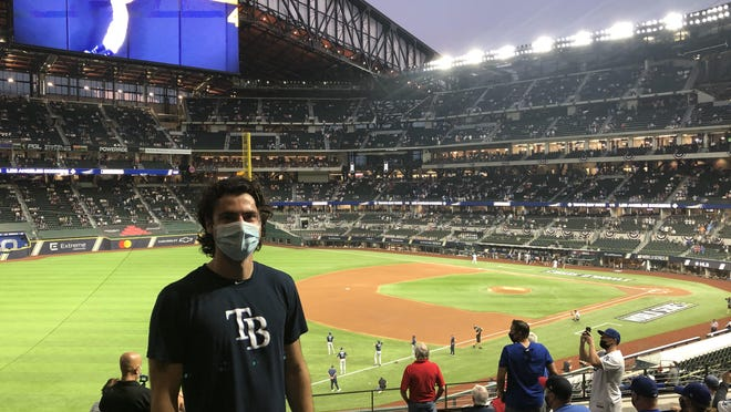 T.C. Roberson High graduate Brad Ballew, who works in the baseball development office of the Tampa Bay Rays, poses for a photo at Globe Life Field in Arlington, Texas, during the World Series.