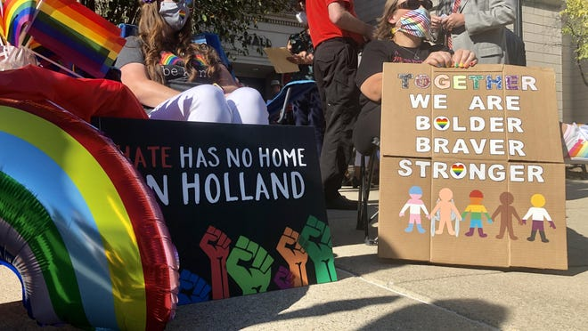 Jenn Manninen, left, and Jill DeJonge show their support for the anti-discrimination ordinance outside Holland City Hall on Wednesday, Aug. 19, 2020.