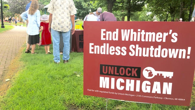 A Michigan group submitted 539,000 signatures Friday to repeal a law that has given Gov. Gretchen Whitmer broad emergency powers during the coronavirus pandemic, demanding that the veto-proof initiative be put before the Republican-led Legislature before year's end.