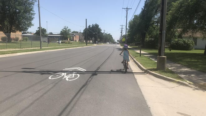 Sharrows arrived on Old Main this spring, and with them some confusion about what the markings mean. Sharrows are designed to designate a bike route for cyclists and alert drivers that cyclists will be on the street.