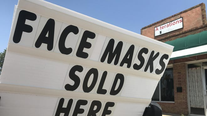 Alterations by Thelma added masks to the store's offerings, made on site, as COVID-19 began spreading in Kansas. Owners are not sure how a pending executive order from Gov. Laura Kelly will affect demand.