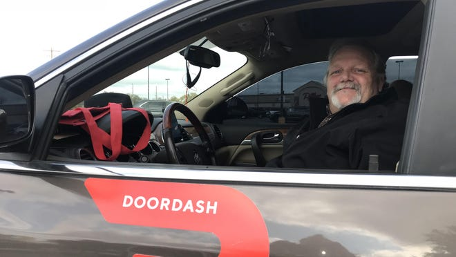 Stephen Tuliszewski stands at the ready to DoorDash, delivering online restaraunt orders in Newton. The service started in Newton this month.