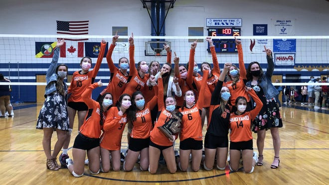 Rudyard celebrates a fifth straight district volleyball championship. The Bulldogs beat the Brimley Bays 3-0 in a Division 4 district final at the Karl Parker Gym Wednesday night.