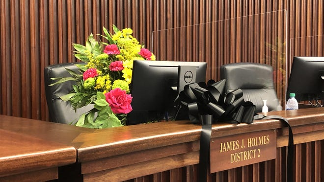 "A black ribbon and flowers were placed at the seat of late Chatham County Commissioner James ""Coach"" Holmes during the board's Aug. 21 meeting."