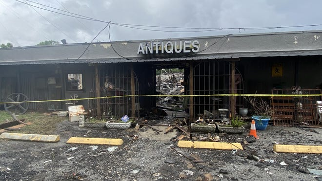 The replica of the Statue of Liberty inside the building is the last piece left standing at the Sandfly Marketplace after an early morning fire Tuesday morning.