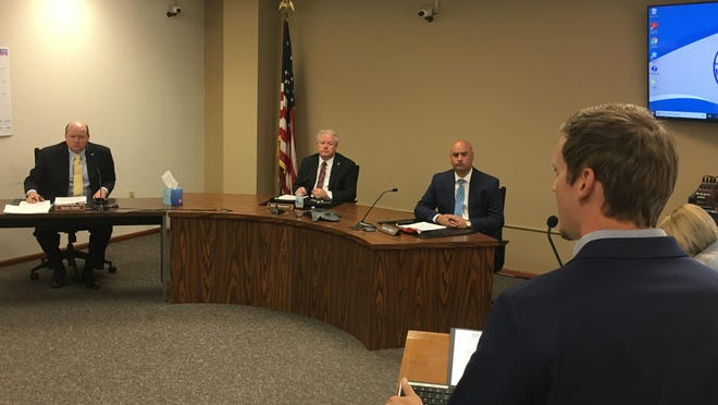 Shawnee County Commissioners, from left, Kevin Cook, Bill Riphahn and Aaron Mays listened at their morning meeting Tuesday to Craig Barnes,