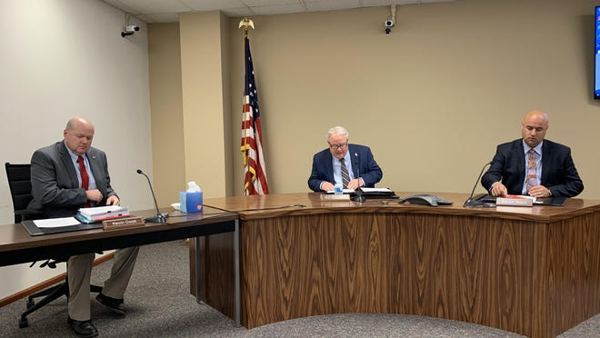 From left, Shawnee County Commissioners Kevin Cook, Bill Riphahn and Aaron Mays conduct business Thursday during the regular Shawnee County Commission meeting. They held a Shawnee County Board of Health meeting directly following the commission meeting and voted unanimously to adopt a Phase 3 amendment that would no longer require Downtown Topeka Farmers Market vendors to wear masks.