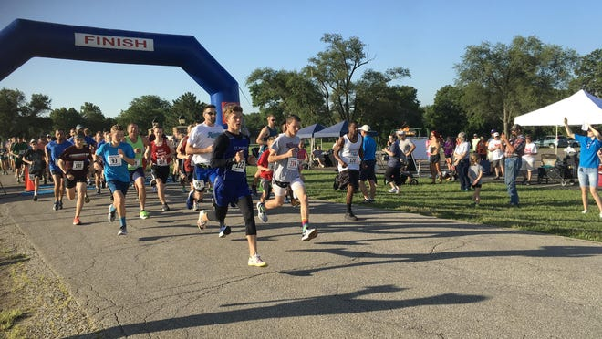 The field starts the race in the 2019 Sunflower State Games Cauldron Run at Lake Shawnee. That event is one of 30 that have been canceled this year due to the coronavirus.