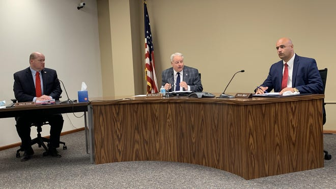 From left, Shawnee County Commissioners Kevin Cook, Bill Riphahn and Aaron Mays conduct business Thursday during their regular commission meeting. They voted 3-0 to reject Gov. Laura Kelly's mask mandate and vowed to draft a less restrictive order before their meeting on Monday.