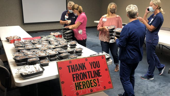 Employees at Stormont Vail Health on Friday picked up free lunches provided by Panda Express.