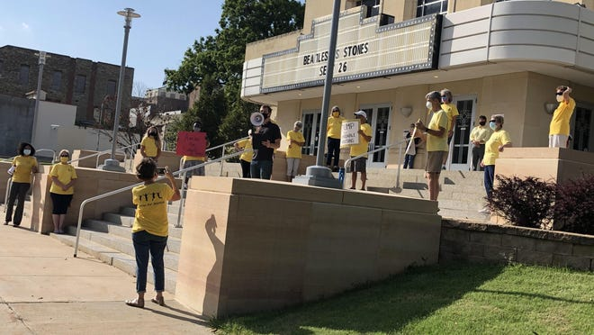 Members of Topeka JUMP rally in front of the Topeka City Council chambers before Tuesday's council meeting.