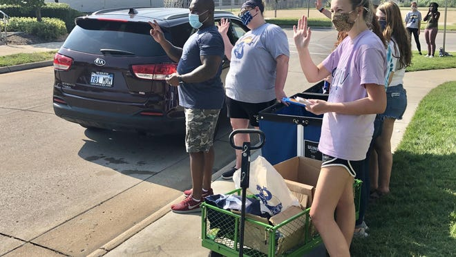 "Washburn University students and staff waved Saturday while taking part in an annual occurrence known as ""The Little Event."""