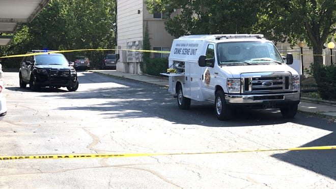 Law enforcement vehicles were present and yellow crime scene tape was up Sunday mornng at a homicide scene on the north side of Prospect Hills Apartments, 710 S.W. Fairlawn Road.
