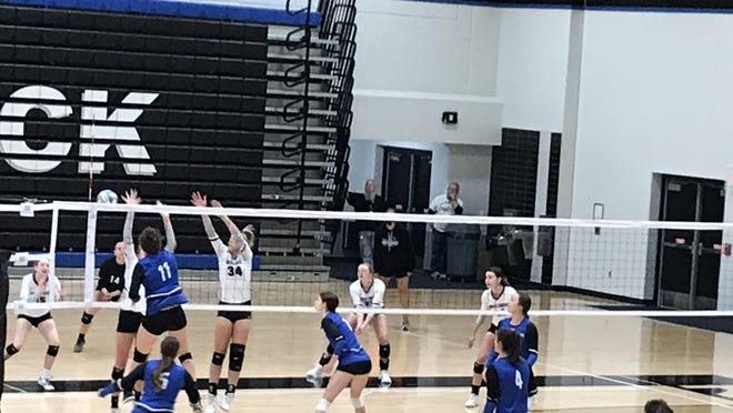 Sabetha's Leah Renyer (11) slams home a kill during the Bluejays' tournament last Saturday at Rock Creek. Renyer has been a driving force behind Sabetha's 14-0 start, leading the team with 119 kills.