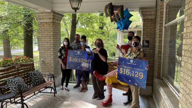 Ronald McDonald House Charities of Northeast Kansas receives $16,129 Tuesday morning from Capitol Federal as part of the bank's 127th birthday celebration.