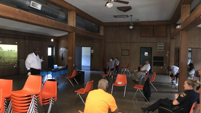 Community leaders, members of law enforcement and influences gather Thursday at Forest Park Conference and Retreat Center for a discussion about race relations in Topeka.