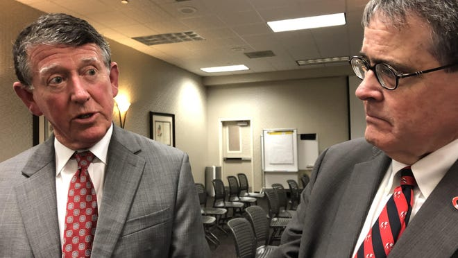 University of Georgia president Jere Morehead (right) and director of athletics Greg McGarity (left).