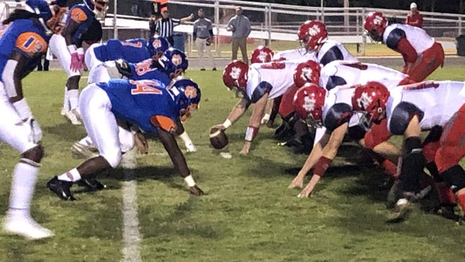 Cedar Shoals lines up against Madison County Friday night at Waters-Wilkins Stadium in Athens. The Jaguars won 23-7.
