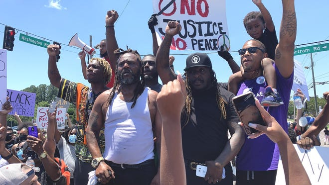 Peaceful protesters gather at the intersection of Washington Road and Bertram Road after a 2-mile march in honor of George Floyd, a black man in Minneapolis who died when a police officer pressed his knee into his neck.