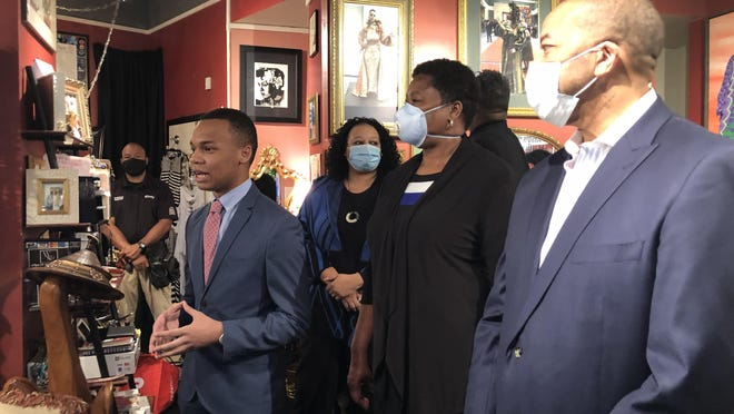CJ Pearson (left) speaks at Wilbourn Sisters Designs in Atlanta June 18, 2020. Pearson raised over $160,000 to assist black-owned businesses damaged during protests across the country.