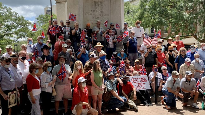 Dozens gathered in front of the Augusta Confederate Monument to counter-protest those who have called for its removal Sunday, Aug. 16.
