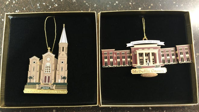 Two of the 500 limited edition Easterseals ornaments. The Most Holy Trinity Catholic Church, right, and the Thomson-McDuffie Government Center are the two ornaments this year.