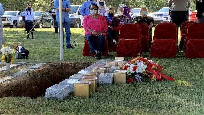 A small group of Aiken County community members sit in silence during a Pauper Burial ceremony at Graniteville Cemetery Friday, Oct. 23 to give 10 deceased Aiken County residents whose bodies were unclaimed or could not be given a funeral for financial reasons a proper burial.
