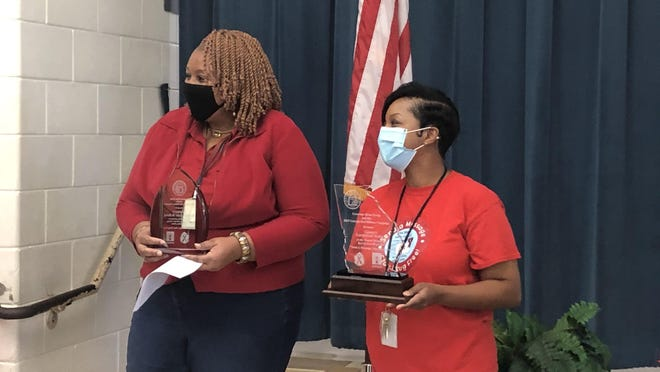 Garrett Elementary Principal Stacey Walk, left, and school counselor Lutricia Parkman, right, received the Governor's Red Ribbon Awards for first place in the overall and elementary school category.