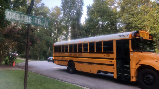 A Columbia County school bus passes the corner of Cactus Trail and Hackamore Trail in Martinez while picking up elementary school students for the first day of school last fall.
