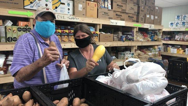Volunteers work at the Community Food Pantry in Edneyville.