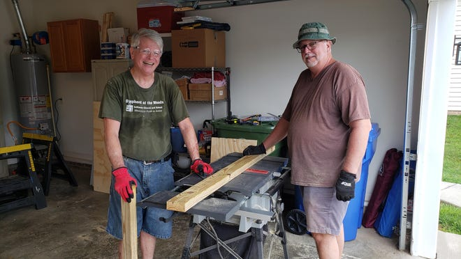Jim Kresge, left, and Michael McPeters, right, both members of our church cutting wood that will be used to build Trinity Lutheran Church's Blessing Box.