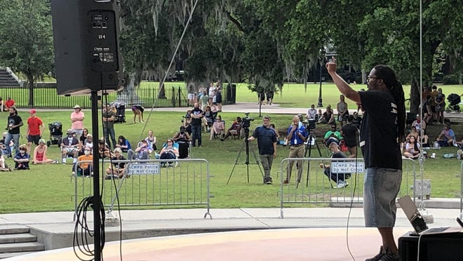 """Moncello Stewart, a community activist with Political Rascals, speaks before hundreds of diverse community members who gathered in Savannah's Forsyth Park for the """"Enough is Enough"""" rally aiming to transform recent protests into a movement on Saturday, June 6."""