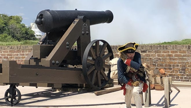 Revolutionary War reenactor Aaron Bradford fires a cannon at Old Fort Jackson on Saturday during Fourth of July activities.