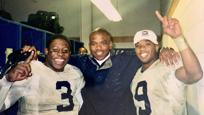 Georgia Southern quarterbacks and fullbacks coach Ivin Jasper (middle) celebrates with fullback Adrian Peterson (3) and wide receiver J.R. Revere (9) after the 2000 Division I-AA national championship game victory over Montana 27-25 on Dec. 16, 2000 in Chattanooga, Tennessee.