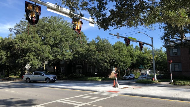 The new HAWK traffic signal and corresponding crosswalk at the intersection of Cedar Street and Victory Drive by Savannah's Daffin Park, being activated on Aug. 19.