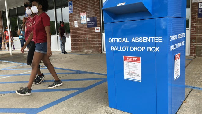 Voters walk by the absentee ballot drop box outside the Chatham County Board of Elections headquarters on Eisenhower drive during the General Primary. The League of Women Voters of Coastal Georgia have raised $30,000 for eight new dropboxes for Chatham County.