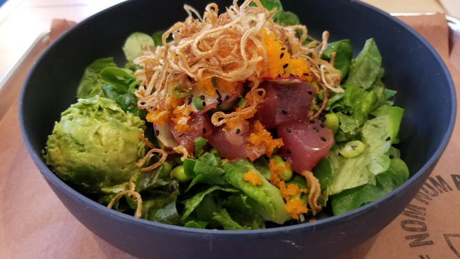 A poke bowl from Nom Nom Poke Shop, located at 1821 Bull St.