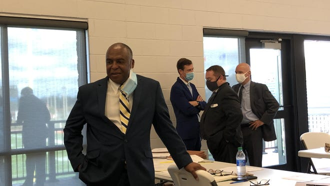 Chatham County Commission District 2 hopeful Tony Riley (left) with his legal team at his Oct. 26 Board of Elections hearing.