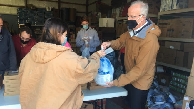U.S. Senator Jerry Moran (R-Kan.) Wednesday helped distribute turkeys  and non-perishable food items collected for the Butler County Salvation Army.