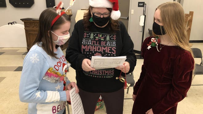 Hays Community Theatre director Cheyrl Glassman, center, goes over musical parts Tuesday evening at Hays Community Theatre with Addy Brull, left, 13, a student at Hays Middle School, and Brook Leiker, right, 14, a freshman at Hays High School.
