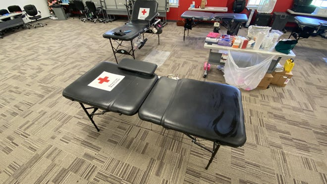 A vacant blood donor chair distanced by six feet from the others to keep donors from potentially spreading COVID-19 during the donation process.